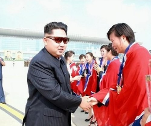 Kim Jong Un meets with North Korea's women's soccer team at airport