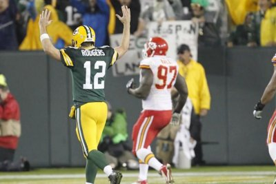 Rodgers throws five TDs as Packers roll past Chiefs