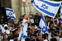 Several injured amid clashes during controversial flag march in Jerusalem