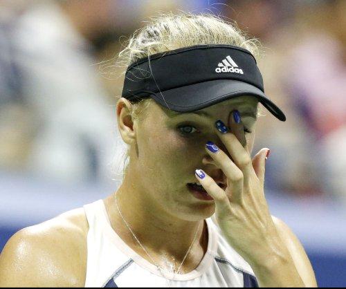 Caroline Wozniacki survives, Venus Williams upset at ASB Classic