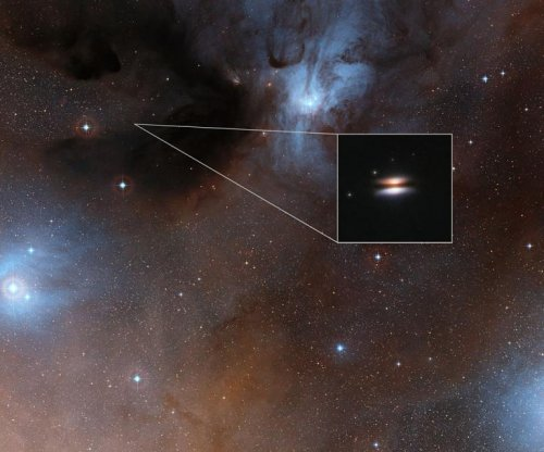Super-cold flying saucer: ALMA spots frozen protoplanetary disk