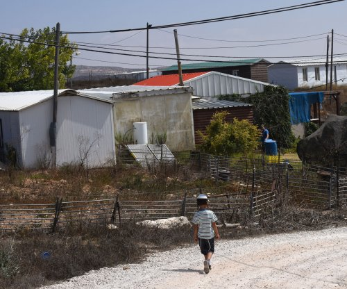 Israel's parliament preliminarily approves settlement legalization