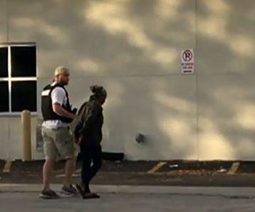Three arrested amid manhunt for suspected Orlando police killer