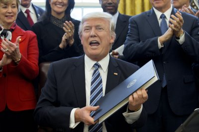 Trump signs executive order to eliminate government waste