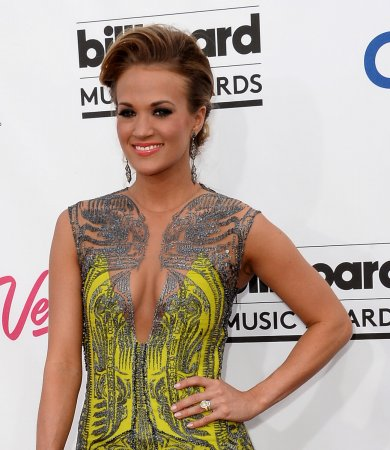 Carrie Underwood details pregnancy, announces new single