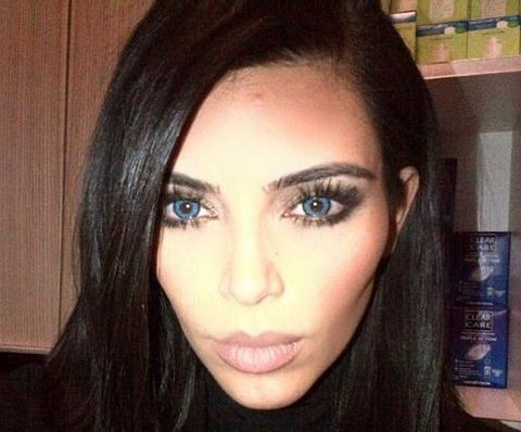 Kim Kardashian, Kanye West sport blue contacts as 'Wolves'