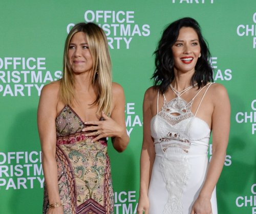 Jennifer Aniston, Olivia Munn turn up for laughs at 'Office Christmas Party' premiere