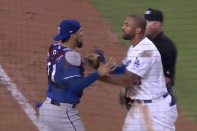 Home plate collision results in Dodgers, Rangers scrum