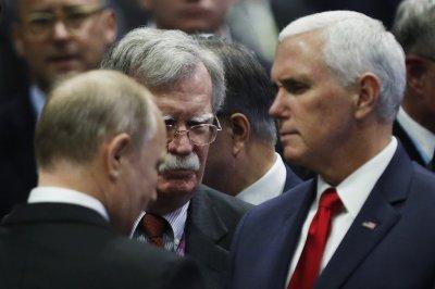 Pence, Putin, Bolton talk briefly at Asian summit
