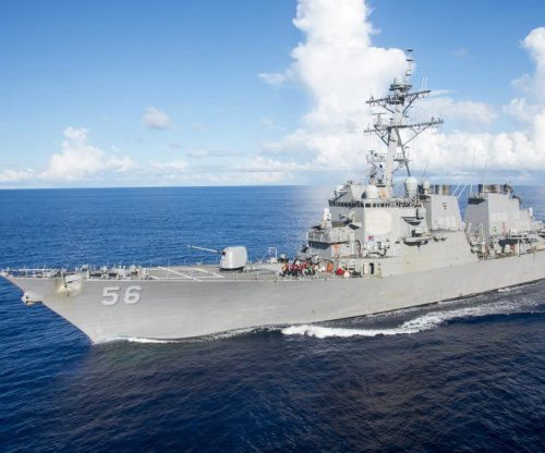 U.S. Navy warship collides with oil tanker near Singapore; 10 sailors missing
