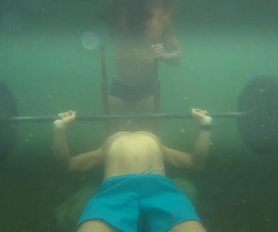 Russian athlete breaks Guinness record for underwater bench press