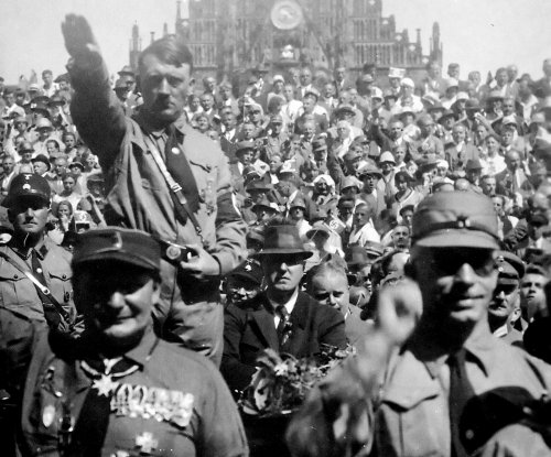 Hitler leads in Saar ballot, refugee exodus begins