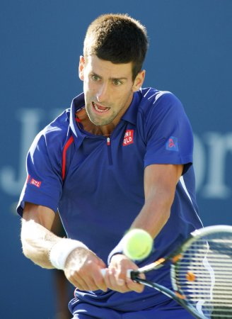 Djokovic wins 5-set thriller