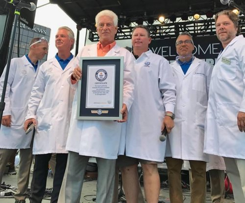 USANA gathers world's largest group of people dressed as scientists