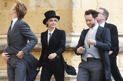 Cara Delevingne wears suit, top hat to royal wedding