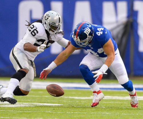 Giants release RB Hillis