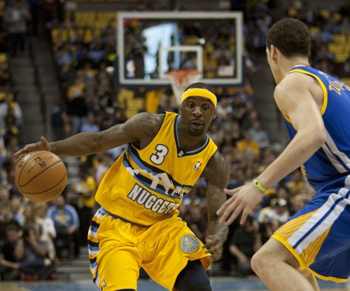 Ty Lawson, Denver Nuggets hold off Lakers in OT