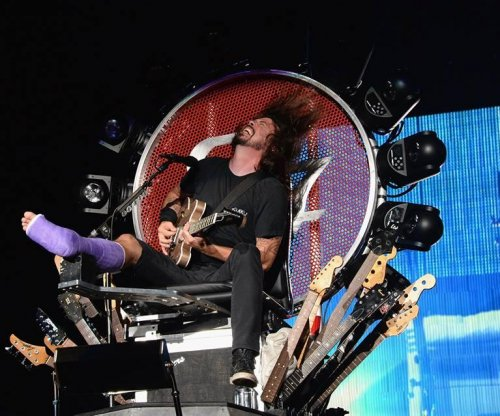 Foo Fighters Dave Grohl performs on a throne