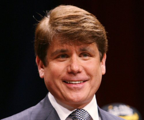Ex-Illinois governor Blagojevich, family stunned by same prison sentence