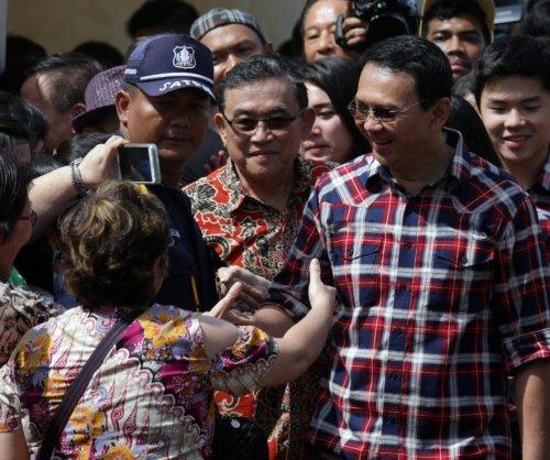 Jakarta governor heading to run-off election despite blasphemy trial