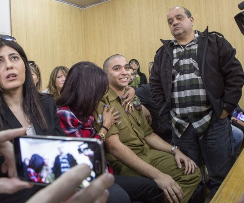 Israeli soldier who killed Palestinian attacker sentenced to 18 months