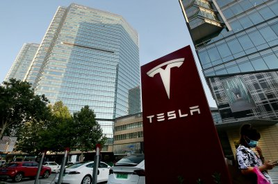 Woman detained in China after Tesla demonstration
