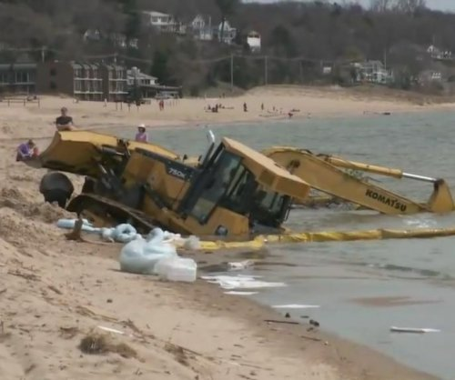 Excavator trying to retrieve bulldozer gets stuck in Lake Michigan