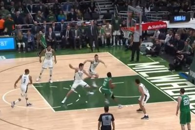 Boston Celtics' Kyrie Irving makes Bucks' Ersan Ilyasova stumble with deceptive handles