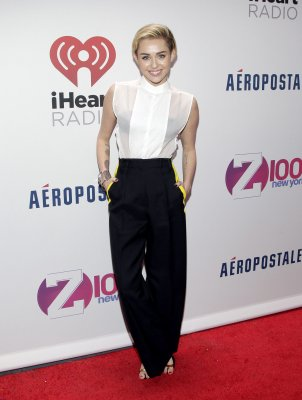 Miley Cyrus introduced by Lindsay Lohan at Z100's Jingle Ball