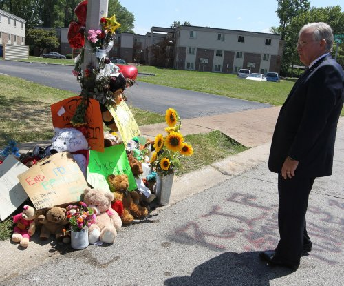 Ferguson officer who called Brown memorial 'pile of trash' gets suspended