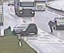 Man chases runaway car across lanes of Switzerland highway