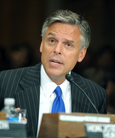 Huntsman attacks Romney's economic record