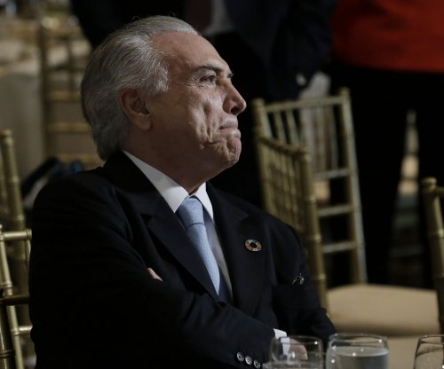Brazilian president denies endorsing corruption hush money
