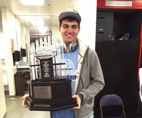 North Carolina Tar Heels' Luke Maye flips car, but is uninjured