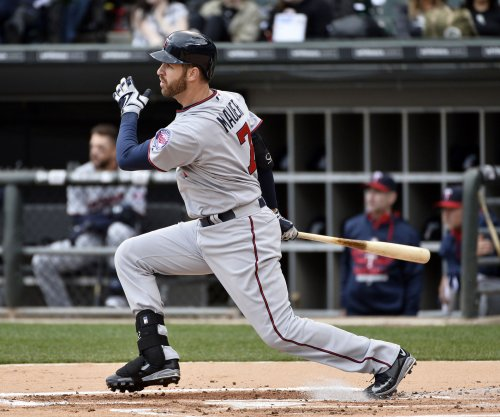 Joe Mauer powers Minnesota Twins in rout Detroit Tigers