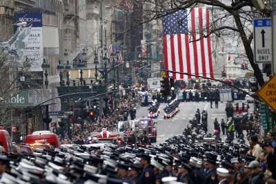 Mourners gather for funeral of firefighter killed on Harlem film set