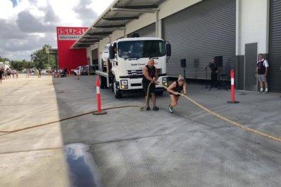 Australian bodybuilder pulls tow truck for Guinness record