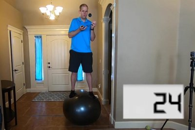 Man marks 522 juggling catches in 1 minute standing on Swiss ball