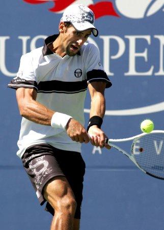Djokovic, Federer move to finals in Dubai