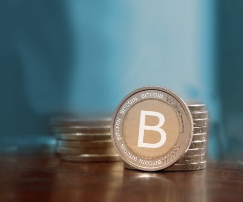 Bitcoin trading above $1,000, highest level in three years