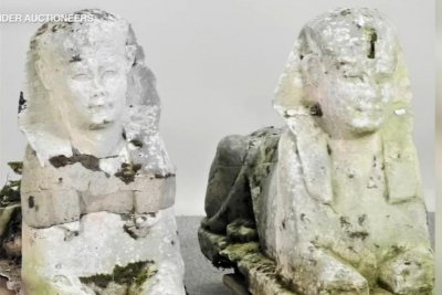 Statues from British garden identified as ancient Egyptian, sell for $265,510