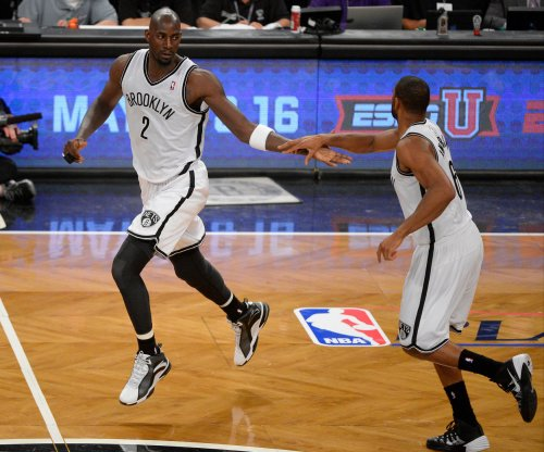 Kevin Garnett blows in ear, draws foul, loses game