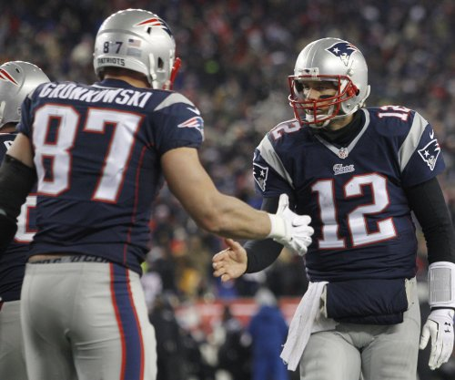 Brady rallies New England Patriots past Baltimore Ravens to reach AFC title game