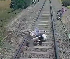 Train's dashboard camera captures motorcycle's demise, rider's near miss