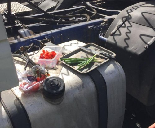 England truck driver fined for making lunch on truck's fuel tank