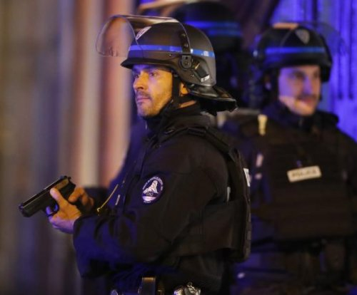 Paris shooting kills police officer, wounds 2; Islamic State claims credit