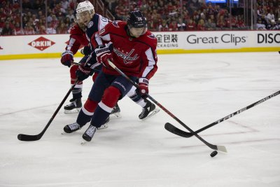 Washington Capitals' Christian Djoos scores with one-handed poke check