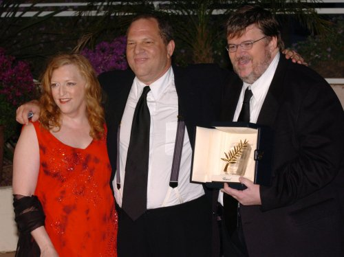 Filmmaker Michael Moore files for divorce from wife of 21 years