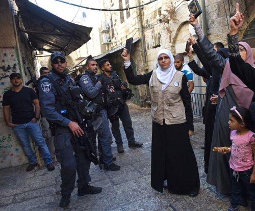 Abbas warns of new violence over Jerusalem mosque