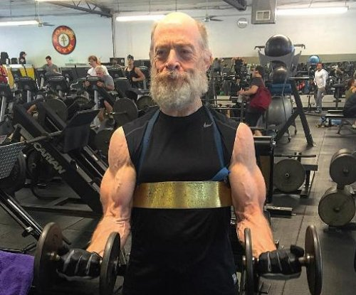 J.K. Simmons explains buff gym photo, likes to 'stay in decent shape'